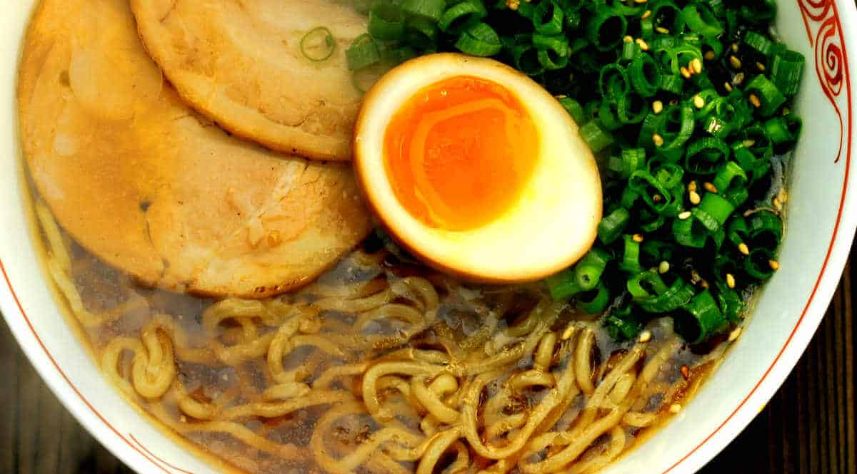 old style shoyu ramen with flavored egg, scallions, and chasiu/slices of braised pork