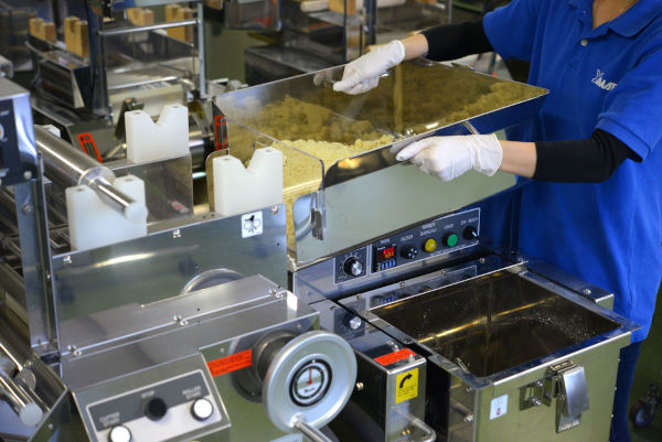 setting up a dough hopper onto a ramen machine