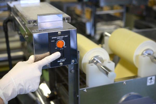 using flour duster during production of ramen noodles on a ramen machine