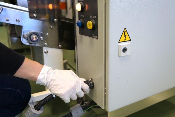 automatic noodle portion conveyor of a ramen noodle machine