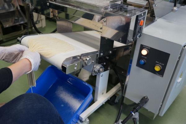 noodle portions on a ramen machine conveyor